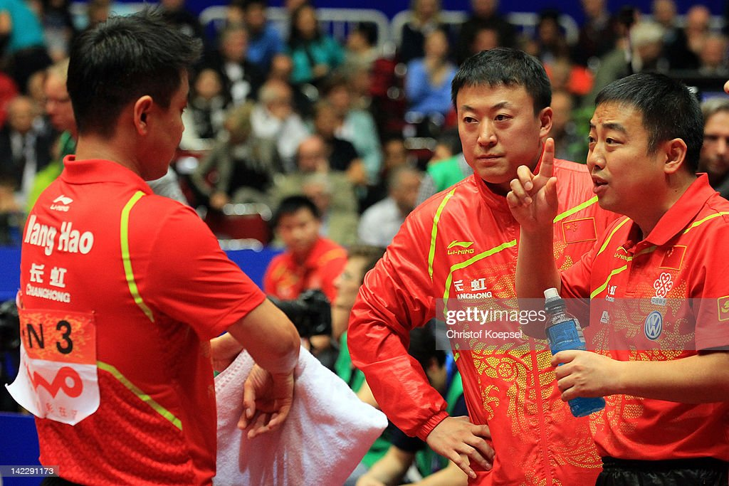 Wang Hao, <a gi-track='captionPersonalityLinkClicked' href=/galleries/search?phrase=Ma+Lin&family=editorial&specificpeople=657281 ng-click='$event.stopPropagation()'>Ma Lin</a>and coach <a gi-track='captionPersonalityLinkClicked' href=/galleries/search?phrase=Liu+Guoliang&family=editorial&specificpeople=655363 ng-click='$event.stopPropagation()'>Liu Guoliang</a> of China talk during the LIEBHERR table tennis team world cup 2012 championship division men's final match between China and Germany at Westfalenhalle on April 1, 2012 in Dortmund, Germany. China won 3-0 against Germany and won the World Cup.