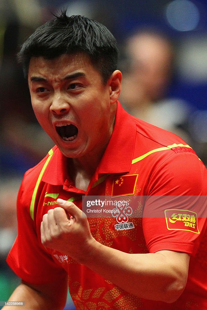 Wang Hao of China celebrates during his match against Patrick Baum of Germany during the LIEBHERR table tennis team world cup 2012 championship...