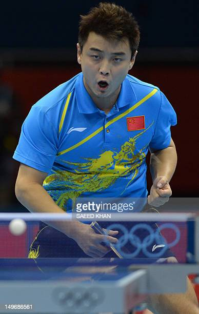 Wang Hao of China celebrates winning a point during his table tennis men's gold medal singles match against compatriot Zhang Jike for the London 2012...