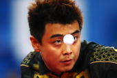 Wang Hao of China competes against Ma Lin of China in the Men's Singles Gold Medal Match held at the Peking University Gymnasium on Day 15 of the...