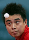 Wang Hao of China eyes the ball as he serves during the Men's Table Tennis singles final during the 15th Asian Games Doha 2006 at the AlArabi Indoor...
