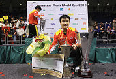 Wang Hao of China is pictured with the cup after winning the Table Tennis World Cup 2010 final match against Jike Zhang of China at the Boerdeland...