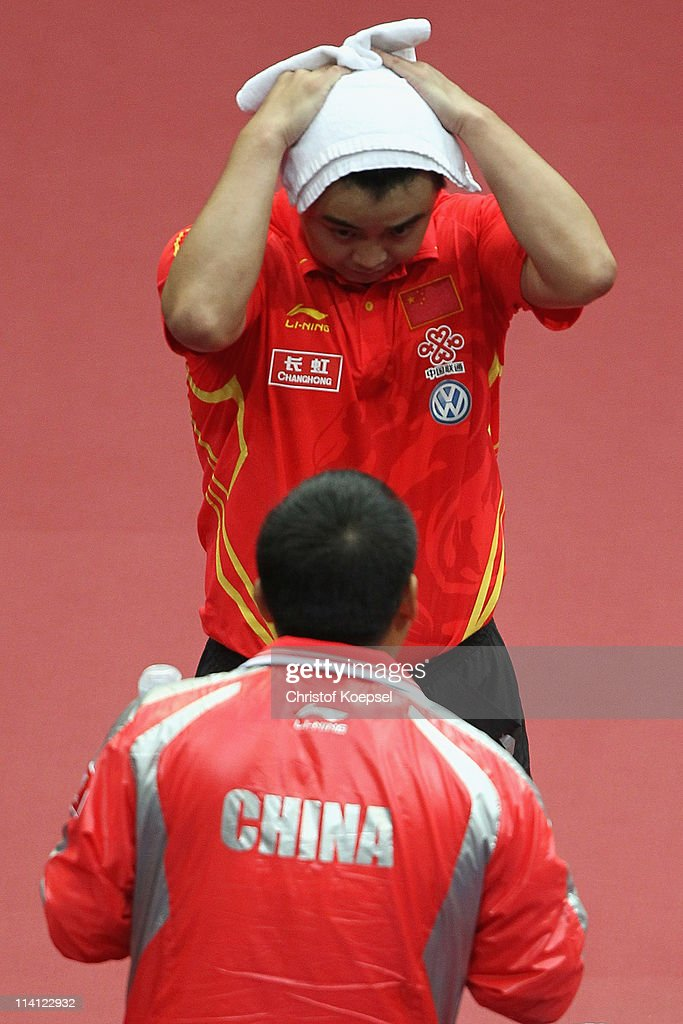 Wang Hao of China looks thoughtful during a break with natiuonal coach Lui Guoliang of China during the Round 32 Men's Single match between Wang Hao of China and Ryu Seung Min of South-Korea during the World Table Tennis Championships at Ahoy Arena on May 12, 2011 in Rotterdam, Netherlands. Wang Hao of China won 4-3 against Ryu Seung Min of South-Korea.