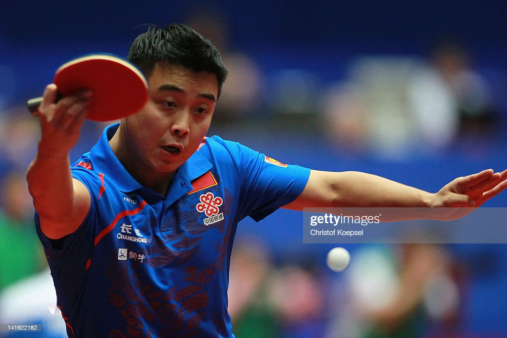 Wang Hao of China plays a backhand during his match against Jan Song Man of Korea DPR during the LIEBHERR table tennis team world cup 2012...