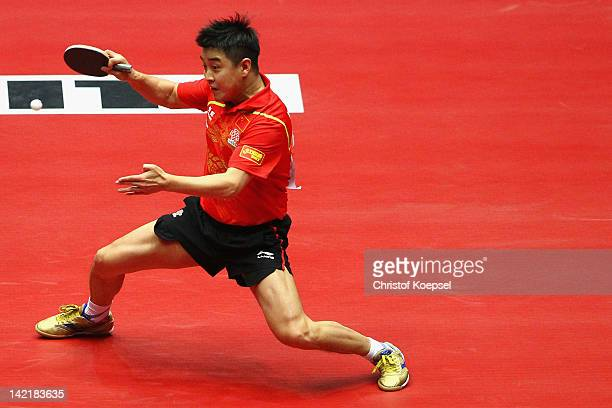 Wang Hao of China plays a forehand during his match against Ryu Seung Min of South Korea during the LIEBHERR table tennis team world cup 2012...