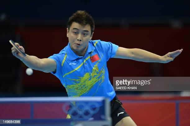 Wang Hao of China plays a return during his table tennis men's gold medal singles match against compatriot Zhang Jike for the London 2012 Olympic...