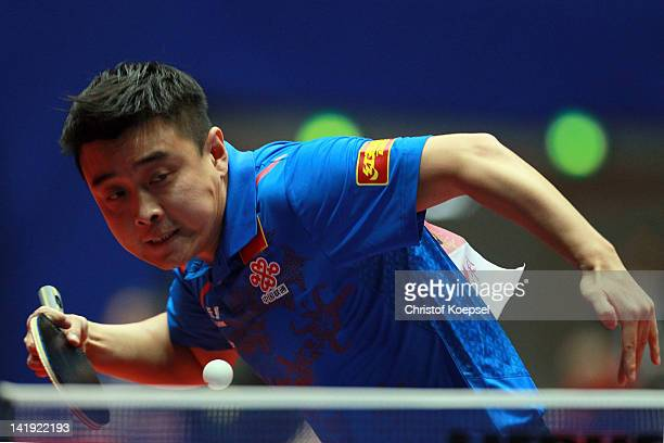 Wang Hao of China serves during his match against Jan Song Man of Korea DPR during the LIEBHERR table tennis team world cup 2012 championship...