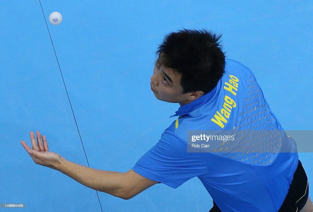 Wang Hao of China serves during Men's Singles Table Tennis Gold medal match against Zhang Jike of China on Day 6 of the London 2012 Olympic Games at...