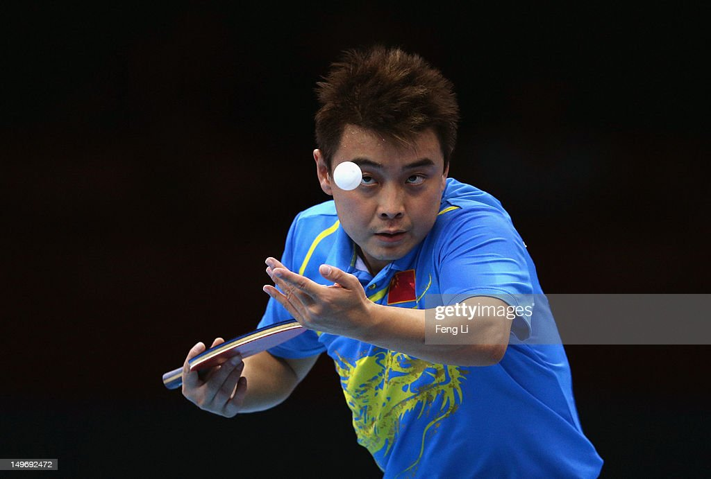 <a gi-track='captionPersonalityLinkClicked' href=/galleries/search?phrase=Wang+Hao+-+Table+Tennis+Player&family=editorial&specificpeople=4649569 ng-click='$event.stopPropagation()'>Wang Hao</a> of China serves on during Men's Singles Table Tennis Gold medal match against Zhang Jike of China on Day 6 of the London 2012 Olympic Games at ExCeL on August 2, 2012 in London, England.