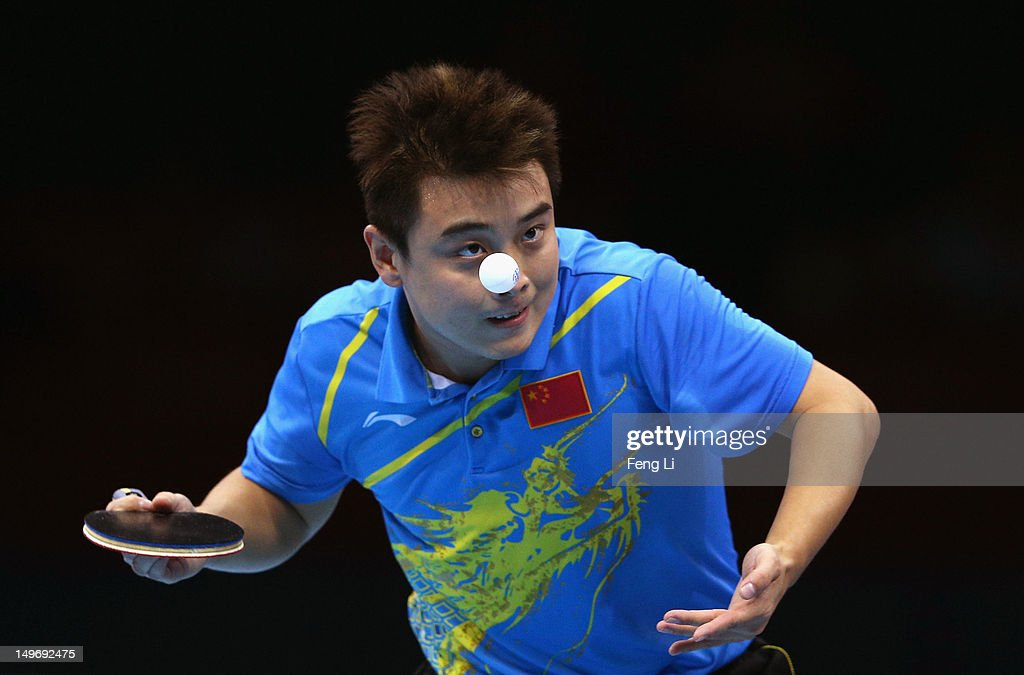 Wang Hao of China serves on during Men's Singles Table Tennis Gold medal match against Zhang Jike of China on Day 6 of the London 2012 Olympic Games...