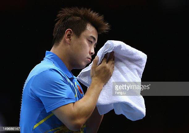 Wang Hao of China towels down during Men's Singles Table Tennis Gold medal match against Zhang Jike of China on Day 6 of the London 2012 Olympic...