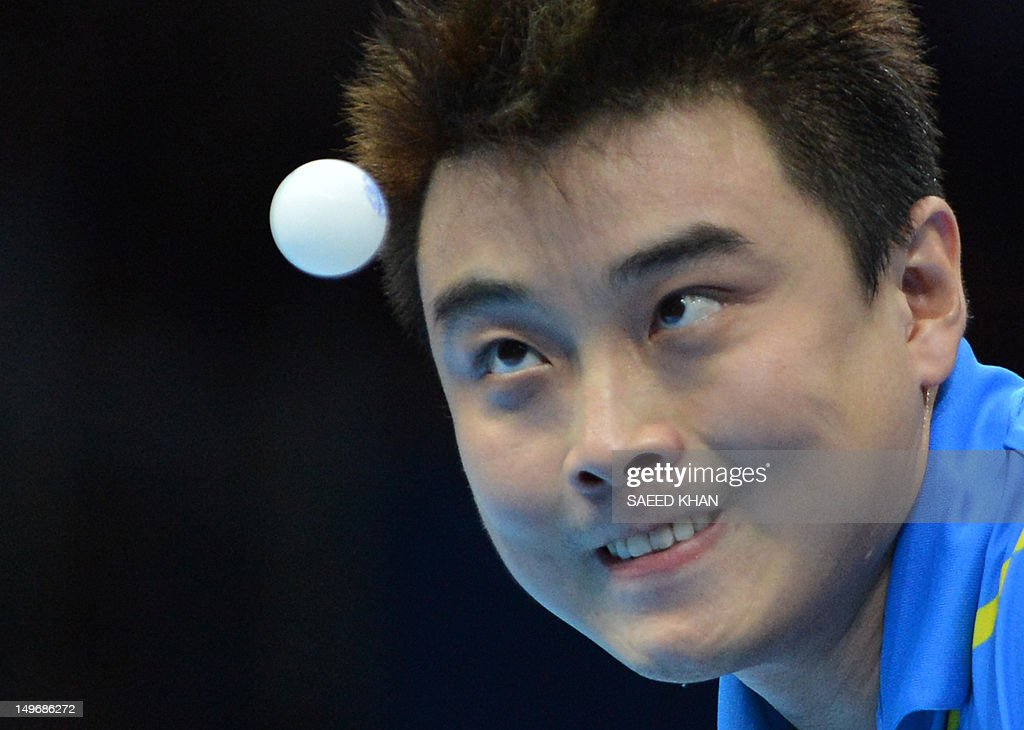 <a gi-track='captionPersonalityLinkClicked' href=/galleries/search?phrase=Wang+Hao+-+Table+Tennis+Player&family=editorial&specificpeople=4649569 ng-click='$event.stopPropagation()'>Wang Hao</a> of China watches the ball as he serves during his table tennis men's gold medal singles match against compatriot Zhang Jike for the London 2012 Olympic Games at The Excel Centre in London on August 2, 2012.