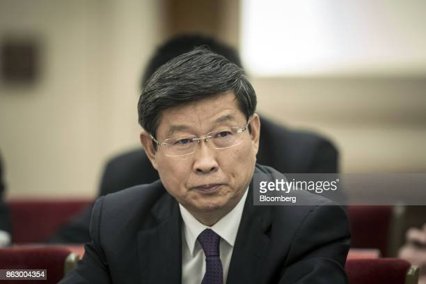 Wang Hongzhang chairman of China Construction Bank Corp attends a delegation meeting at the Great Hall of the People during the 19th National...