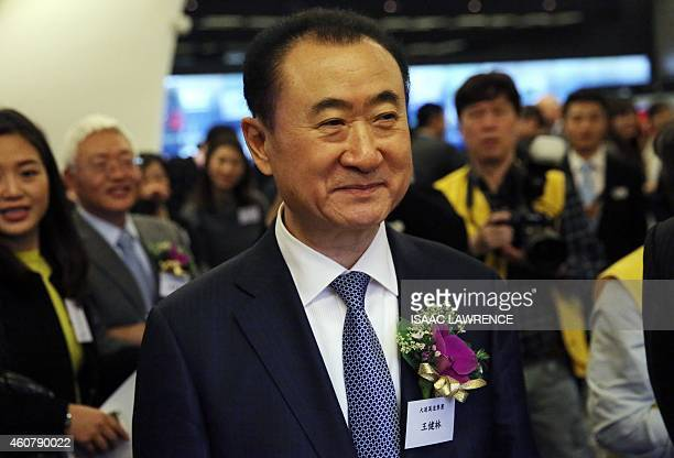 Wang Jianlin CEO of Dalian Wanda Commercial Properties Co arrives for the company's IPO at the Hong Kong stock exchange on December 23 2014 Chinese...