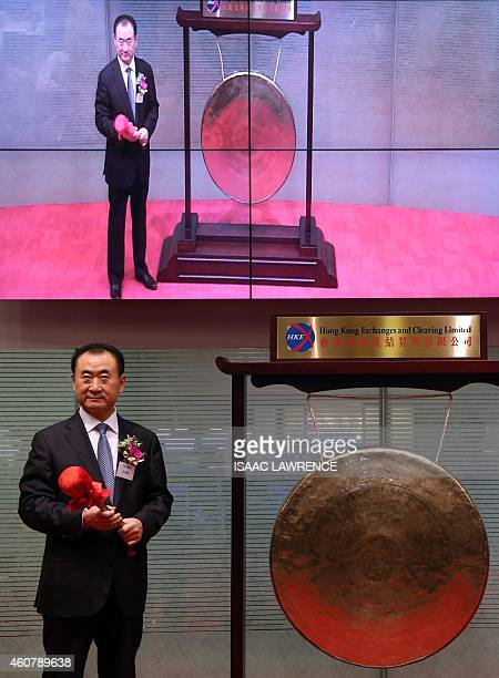 Wang Jianlin CEO of Dalian Wanda Commercial Properties Co opens trading during the company's IPO at the Hong Kong stock exchange on December 23 2014...