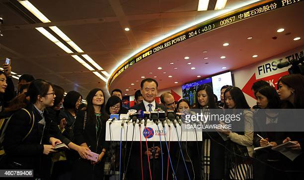 Wang Jianlin CEO of Dalian Wanda Commercial Properties Co speaks at a press conference during the company's IPO at the Hong Kong stock exchange on...