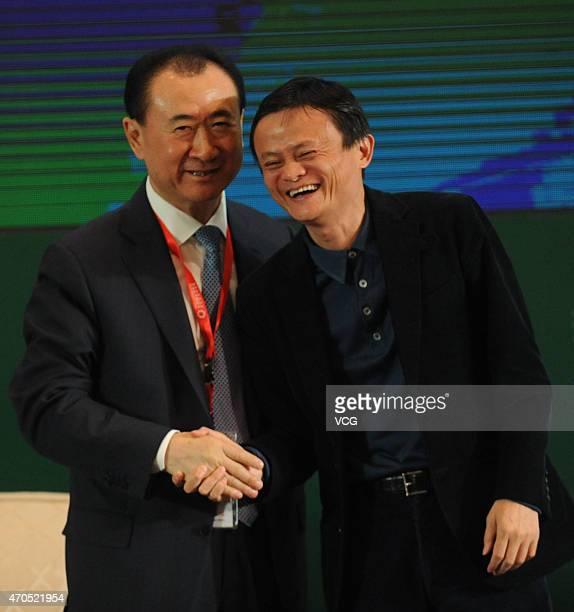 Wang Jianlin Chairman of the Dalian Wanda Group shakes hands with Jack Ma Executive Chairman of Alibaba Group during the 2015 China Green Companies...
