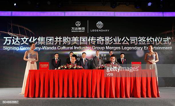 Wang Jianlin Chairman of Wanda Group and Thomas Tull CEO of Legendary Pictures during the signing ceremony as Wanda Cultural Industry Group buy...