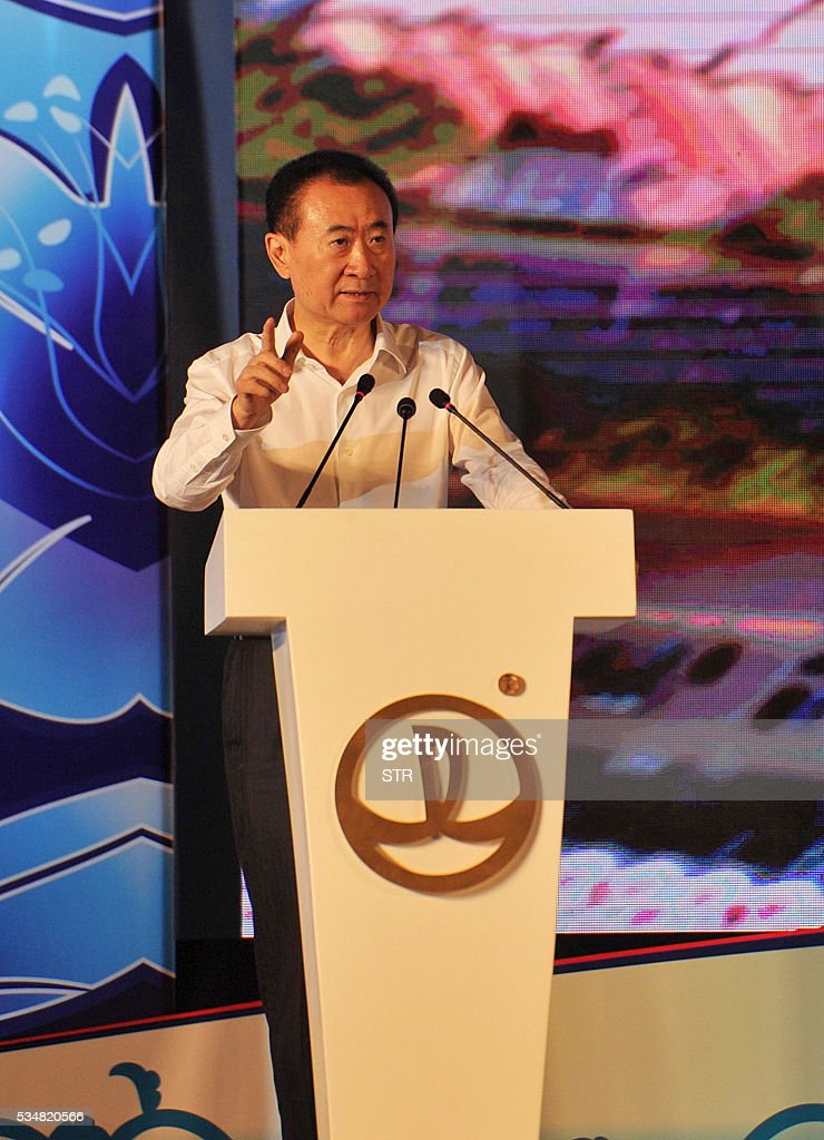 Wang Jianlin, chairman of Wanda Group speaks during an opening ceremony of 'Wanda City' in Nanchang, east China's Jiangxi province on May 28, 2016. The Chinese conglomerate Wanda on May 28 opened its first theme park, with its billionaire boss declaring war on Disney weeks before the American entertainment giant launches a similar attraction in Shanghai. / AFP / STR / China OUT