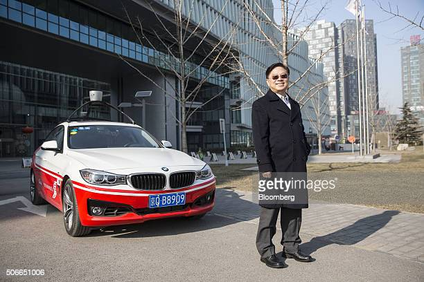 Wang Jing senior vice president of Baidu Inc poses for a photograph next to the company's autonomous car at the company's headquarters in Beijing...