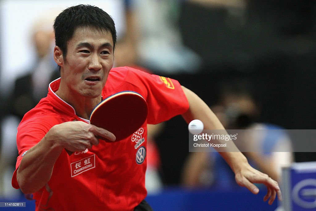 <a gi-track='captionPersonalityLinkClicked' href=/galleries/search?phrase=Wang+Liqin&family=editorial&specificpeople=221536 ng-click='$event.stopPropagation()'>Wang Liqin</a> of China plays a backhand during the Round of 16 Men's Single match between <a gi-track='captionPersonalityLinkClicked' href=/galleries/search?phrase=Wang+Liqin&family=editorial&specificpeople=221536 ng-click='$event.stopPropagation()'>Wang Liqin</a> of China and Xu Xin of China during the World Table Tennis Championships at Ahoy Arena on May 13, 2011 in Rotterdam, Netherlands. <a gi-track='captionPersonalityLinkClicked' href=/galleries/search?phrase=Wang+Liqin&family=editorial&specificpeople=221536 ng-click='$event.stopPropagation()'>Wang Liqin</a> of China won 4-1 against Xu Xin of China.