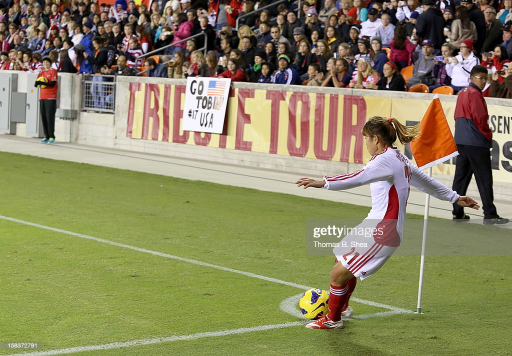 Wang Lisi midfielder #21 of the China Women's National Team kicks a corner kick against the U.S. Women's National Team in an international friendly game at BBVA Compass Stadium on December 12, 2012 in Houston, Texas. USA won 4 to 0.