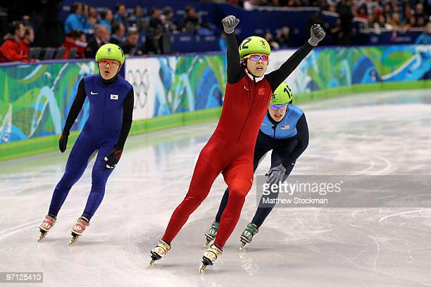 Wang Meng of China celebrates the gold medal in the Ladies 1000m Short Track Speed Skating Final on day 15 of the 2010 Vancouver Winter Olympics at...