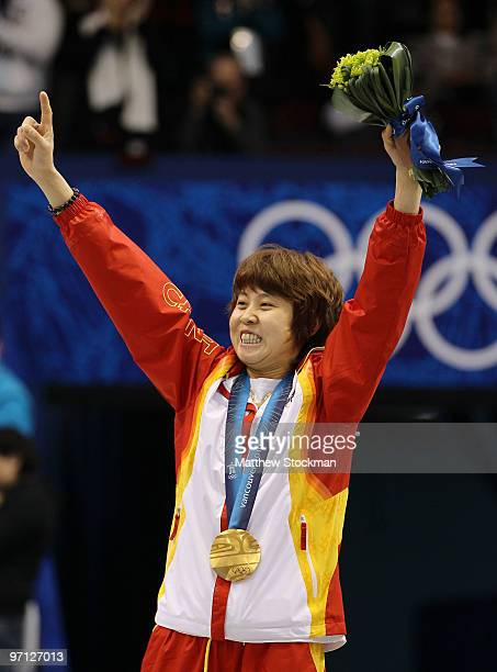 Wang Meng of China celebrates winning the gold medal in the Ladies 1000m Short Track Speed Skating Final on day 15 of the 2010 Vancouver Winter...