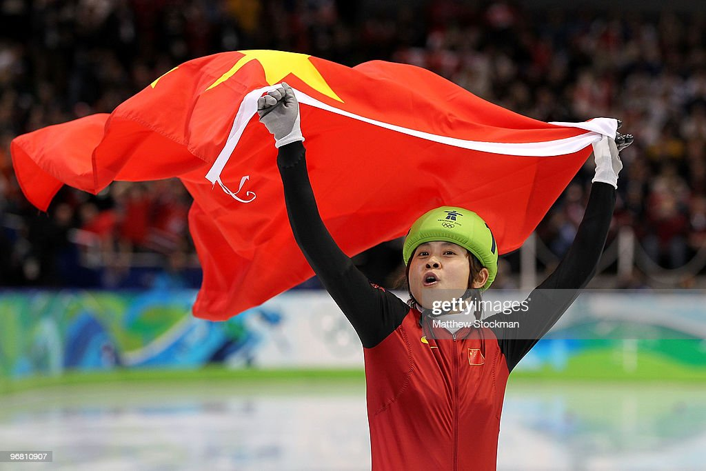 <a gi-track='captionPersonalityLinkClicked' href=/galleries/search?phrase=Wang+Meng&family=editorial&specificpeople=774285 ng-click='$event.stopPropagation()'>Wang Meng</a> of China celebrates winning the gold medal in the Short Track Speed Skating Ladies' 500 m finals on day 6 of the Vancouver 2010 Winter Olympics at Pacific Coliseum on February 17, 2010 in Vancouver, Canada.