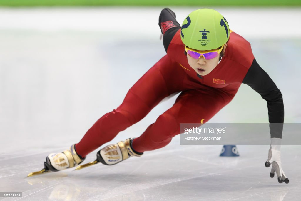 <a gi-track='captionPersonalityLinkClicked' href=/galleries/search?phrase=Wang+Meng&family=editorial&specificpeople=774285 ng-click='$event.stopPropagation()'>Wang Meng</a> of China competes onm her way to breaking an Olympic record in the Ladies' 500 m Short Track on day 2 of the Vancouver 2010 Winter Olympics at Pacific Coliseum on February 13, 2010 in Vancouver, Canada.
