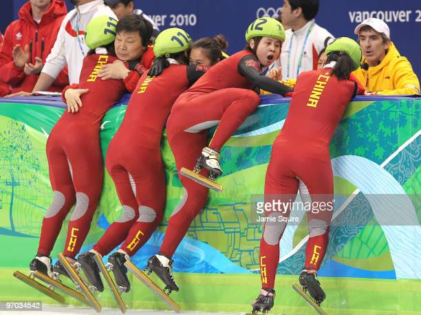 Wang Meng of China reacts after cutting the face of teammate Zhang Hui after Team China won the gold medal in the Short Track Speed Skating Ladies'...