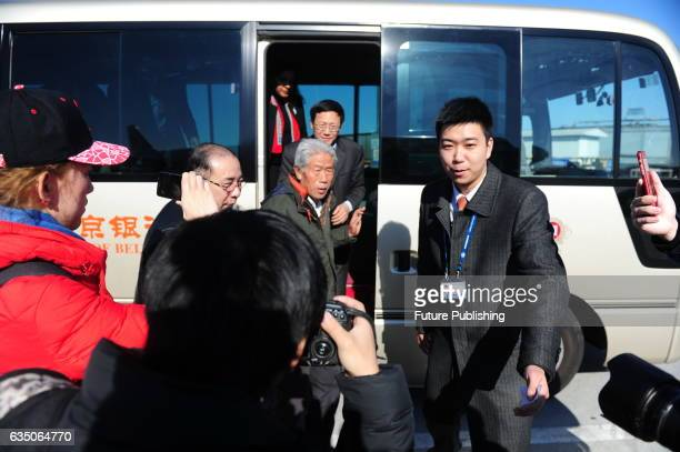 Wang Qi center who has left China for 54 years prepares to board a flight from Beijing to his hometown in Xianyang on February 11 2017 in Shaanxi...