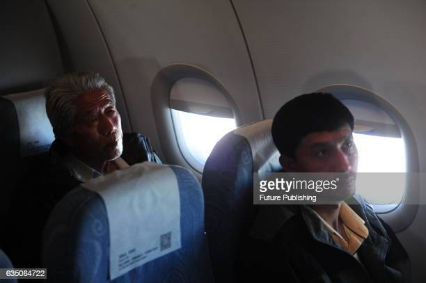 Wang Qi who has left China for 54 years sits on a flight from Beijing to his hometown in Xianyang on February 11 2017 in Shaanxi Beijing China The...
