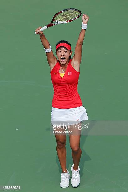Wang Qiang of China celebrates her win over Kumkhum Luksika of Thailand during the Tennis Women's Singles Gold Medal Match on day eleven of the 2014...