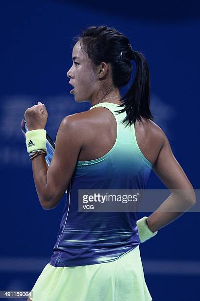 Wang Qiang of China celebrates in the first round of Women's Singles match against Varvara Lepchenko of USA on day one of the 2015 China Open at the...