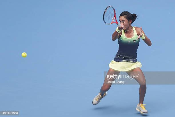 Wang Qiang of China in action against Caroline Wozniacki of Denmark during the Women's singles Second round match on day four of the 2015 China Open...
