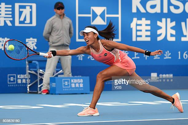 Wang Qiang of China returns a shot against Agnieszka Radwanska of Poland in quarter finals match during Day five of 2016 WTA Shenzhen Open at...