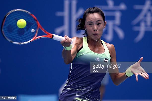 Wang Qiang of China returns a shot against Caroline Wozniacki of Denmark during day four of the 2015 China Open at the China National Tennis Centre...