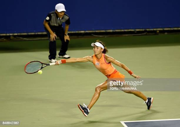 TOPSHOT Wang Qiang of China returns a shot to Kristina Mladenovic of France during their first round match in the Pan Pacific Open tennis tournament...