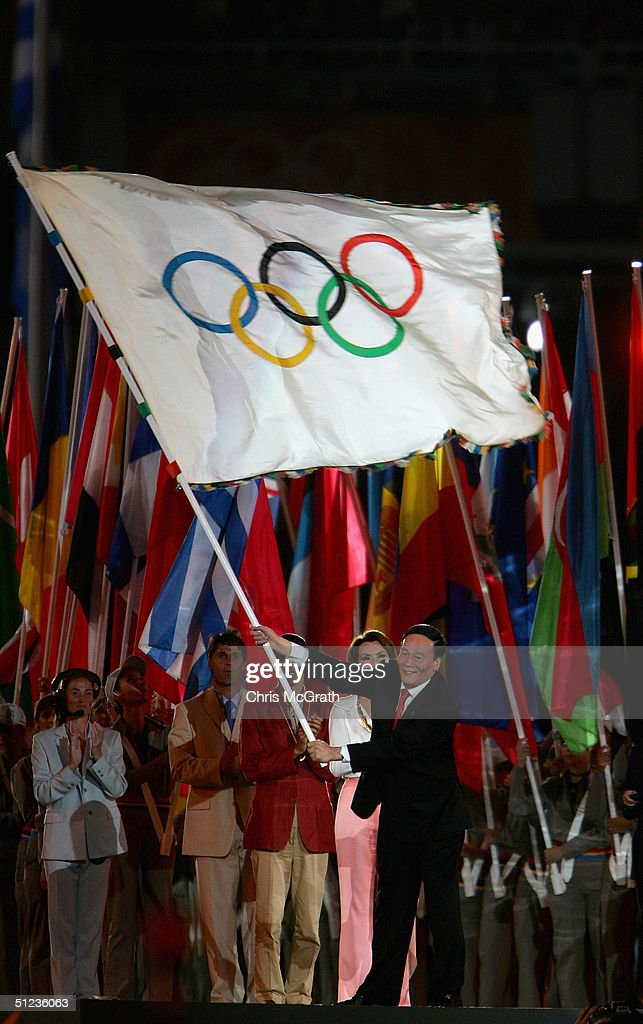 Wang Qishan mayor of Beijing the host city of the Games of the XXIX Olympiad in 2008 waves the Olympic flag during the closing ceremonies of the...