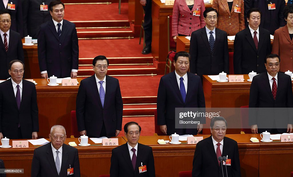 Wang Qishan, member of China's Politburo Standing Committee, second row from left, Zhang Dejiang, member of China's Politburo Standing Committee and chairman of the Standing Committee of the National People's Congress, Xi Jinping, China's president, Li Keqiang, China's premier, and Yu Zhengsheng, member of China's Politburo Standing Committee, front row right, attend the concluding session of the Chinese People's Political Consultative Conference (CPPCC) in Beijing, China, on Friday, March 13, 2015. The Chinese People's Political Consultative Conference, an annual meeting of political advisers, concludes today. Photographer: Tomohiro Ohsumi/Bloomberg via Getty Images