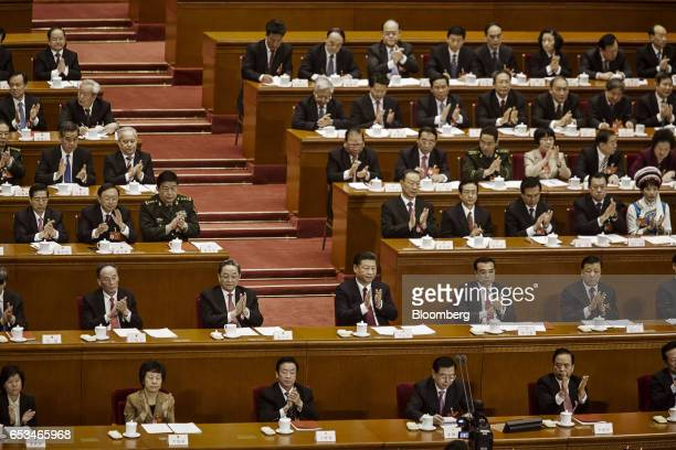 Wang Qishan secretary of the Central Commission for Discipline Inspection second row left to right Yu Zhengsheng chairman of the Chinese People's...