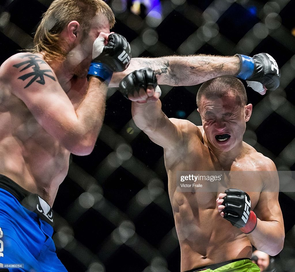 Wang Sai of China and Danny Mitchel of England in action on their welterweight fight during the UFC Fight Night at The Venetian Macao Cotai Arena on...