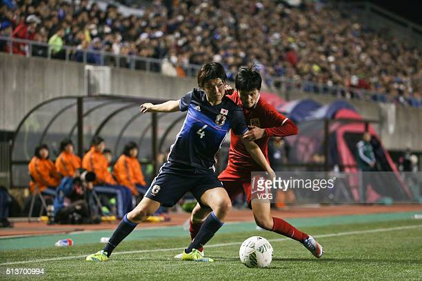 Wang Shanshan of China and Kumagai Saki of Japan compete for the ball during the AFC Women's Olympic Final Qualification Round match between Japan...