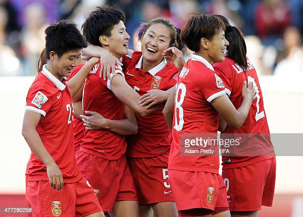 Wang Shanshan of China celebrates with Wu Haiyan of China after scoring the second goal during the FIFA Women's World Cup 2015 Group A match between...