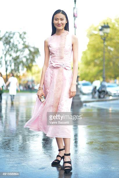 Wang Shiqing poses wearing a Shiatzy Chen dress before the Shiatzy Chen show at the Grand Palais during Paris Fashion Week SS16 on October 6 2015 in...