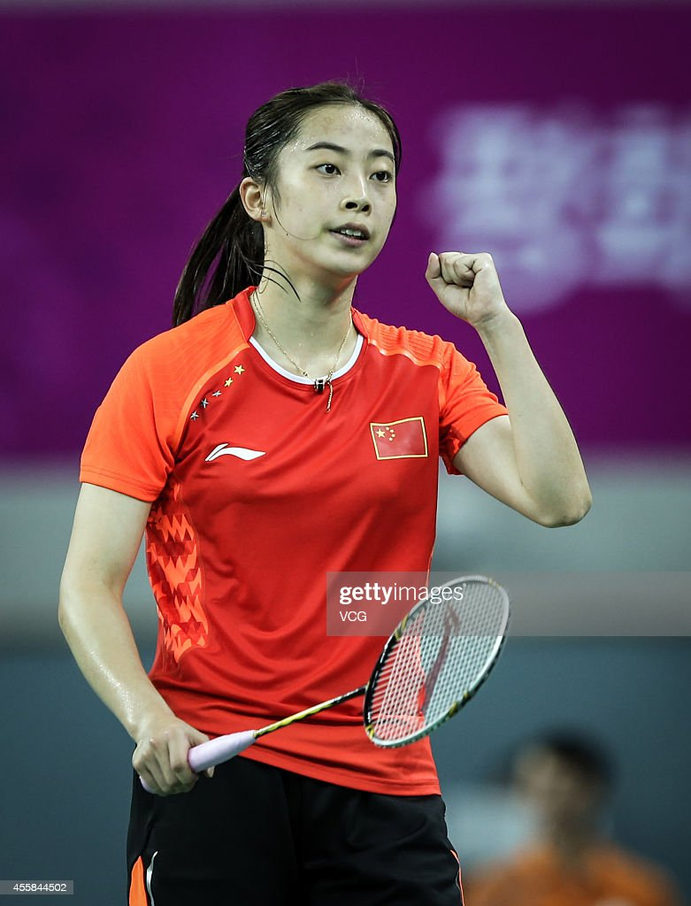 <a gi-track='captionPersonalityLinkClicked' href=/galleries/search?phrase=Wang+Shixian&family=editorial&specificpeople=5777044 ng-click='$event.stopPropagation()'>Wang Shixian</a> competes in quarterfinal of women's team of badminton during day one of the 2014 Asian Games at Gyeyang Gymnasium on September 20, 2014 in Incheon, South Korea.