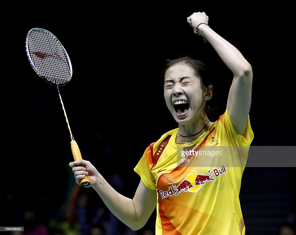 Wang Shixian of China celebrates after beating Eriko Hirose of Japan in the women's singles event of the 2012 BWF Superseries Finals in Shenzhen, in southern China's Guangdong province on December 14, 2012. Wang beat Hirose 21-15, 8-21, 21-15 to move into the next round. AFP PHOTO