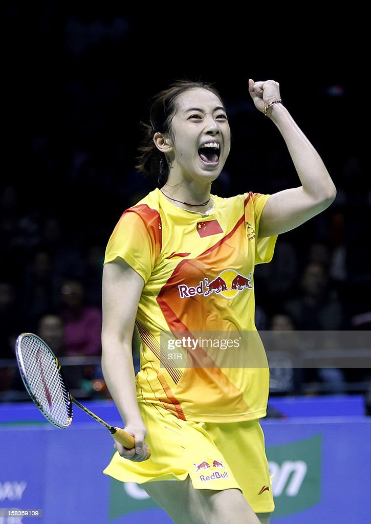 Wang Shixian of China celebrates after beating Eriko Hirose of Japan in the women's singles event of the 2012 BWF Superseries Finals in Shenzhen, in southern China's Guangdong province on December 14, 2012. Wang beat Hirose 21-15, 8-21, 21-15 to move into the next round.