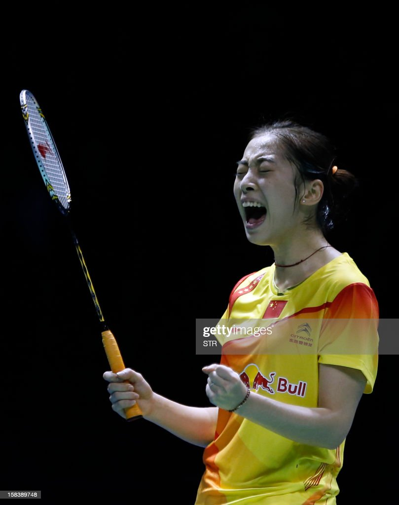 Wang Shixian of China celebrates after beating Ratchanok Intanon of Thailand in the women's singles event of the 2012 BWF Superseries Finals in Shenzhen, south China's Guangdong province on December 15, 2012. Wang beat Ratchanok 21-12, 21-19 to move into the final.